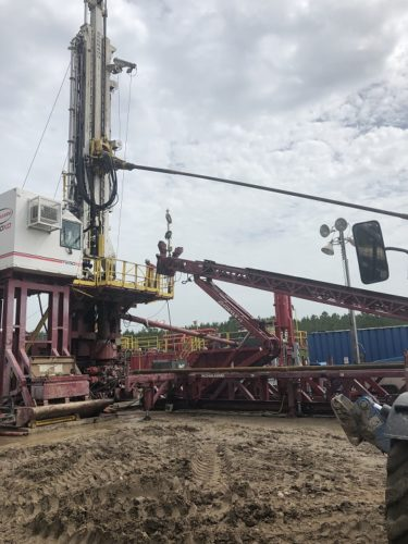 drilling rig with stuck pipe service call