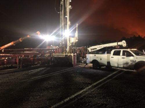 running part of a downed rig with our service truck
